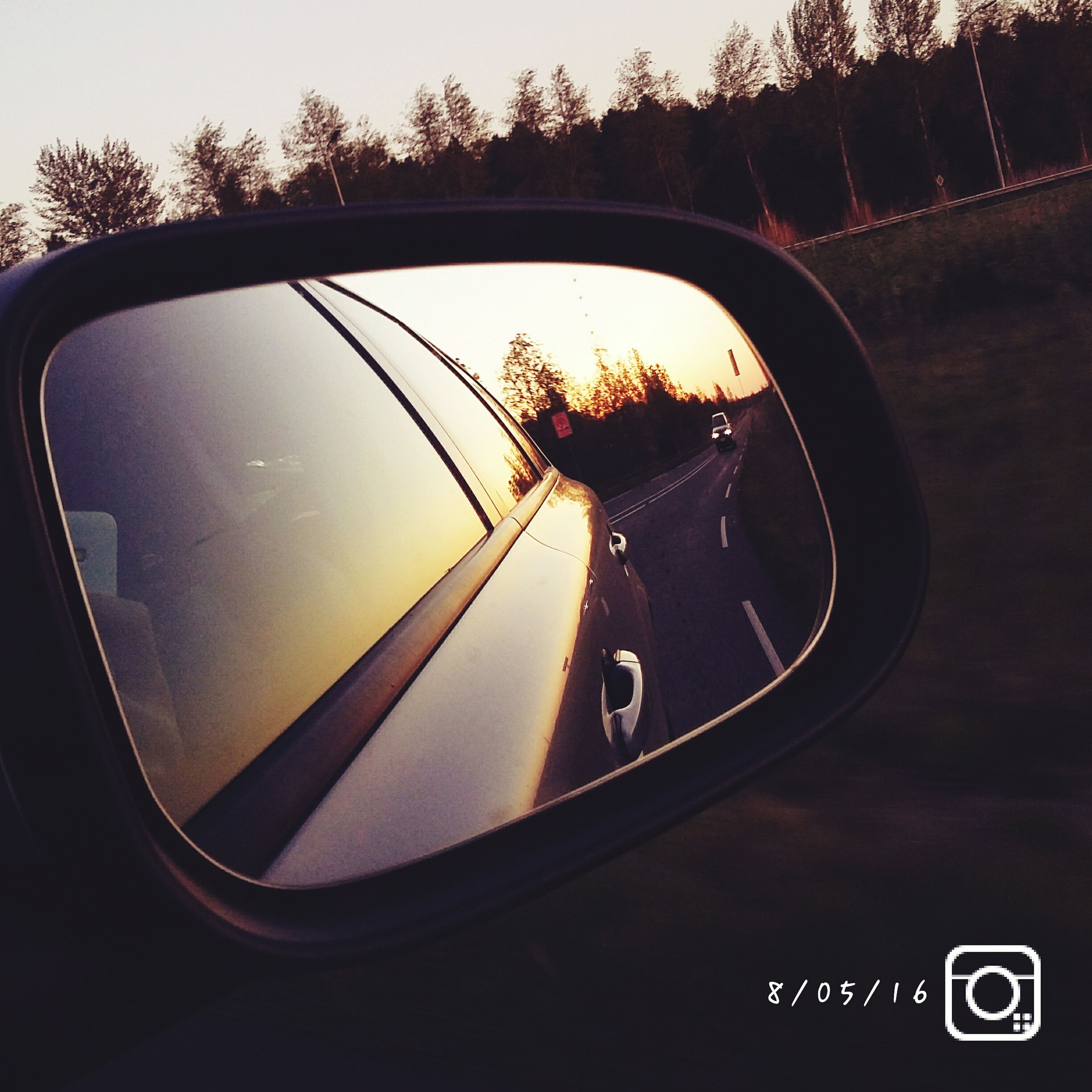 transportation, reflection, land vehicle, side-view mirror, car, sunset, mode of transport, street, road, close-up, part of, sky, orange color, vehicle, no people, cloud - sky