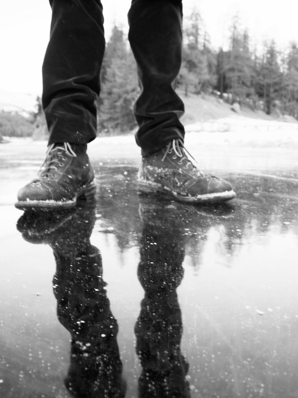 low section, real people, day, water, outdoors, puddle, reflection, wet, lifestyles, one person, nature, winter
