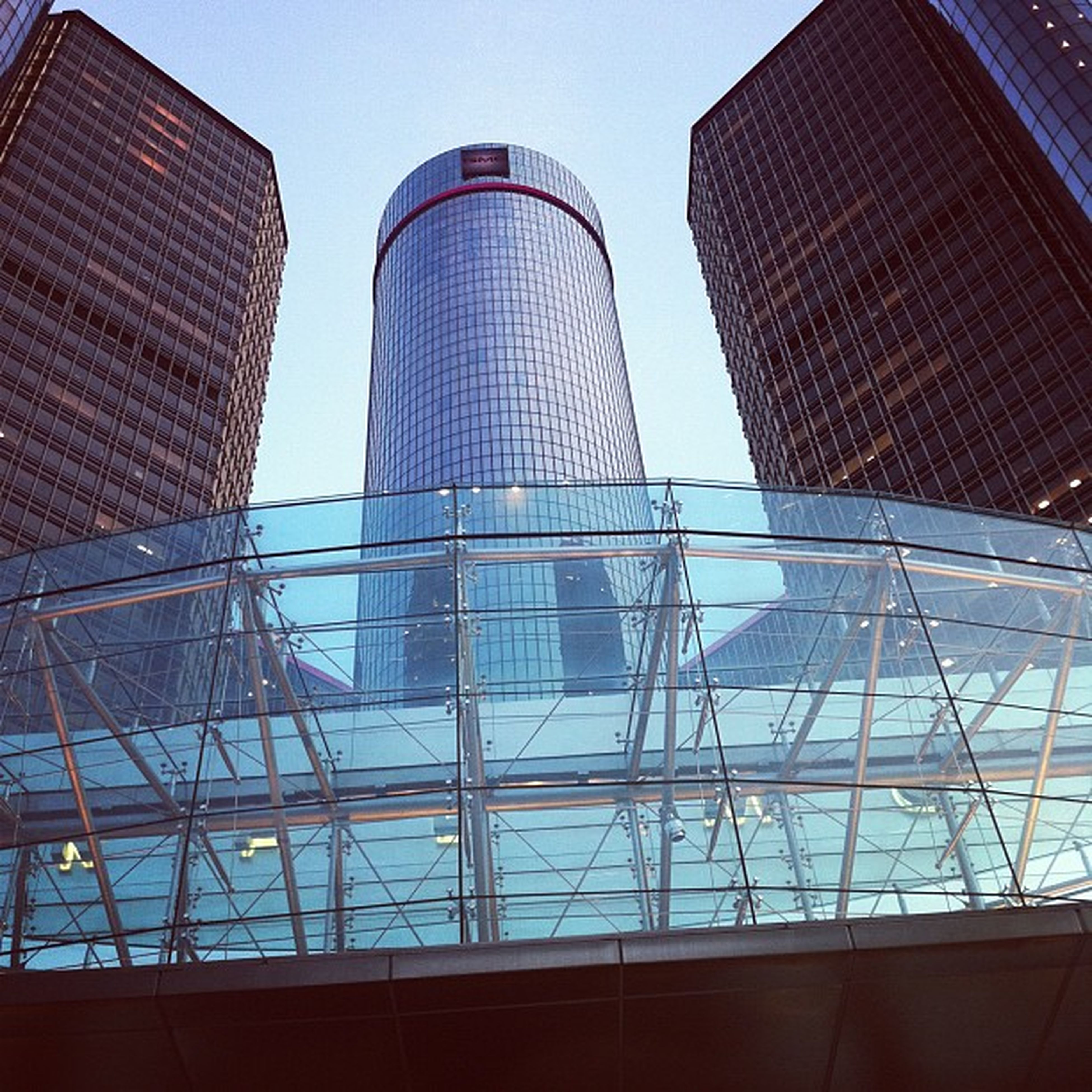 low angle view, architecture, built structure, building exterior, modern, office building, glass - material, tower, tall - high, clear sky, city, sky, building, skyscraper, pattern, day, reflection, no people, outdoors, architectural feature