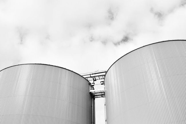 Low Angle View Built Structure Sky Building Exterior Cloud Outdoors Industrial Dramatic Angles Blackandwhite Black And White Circular Lookingup Outdoor Photography Urban Urban Geometry Taking Photos Eye4photography  EyeEm Gallery Exploring Cloud - Sky