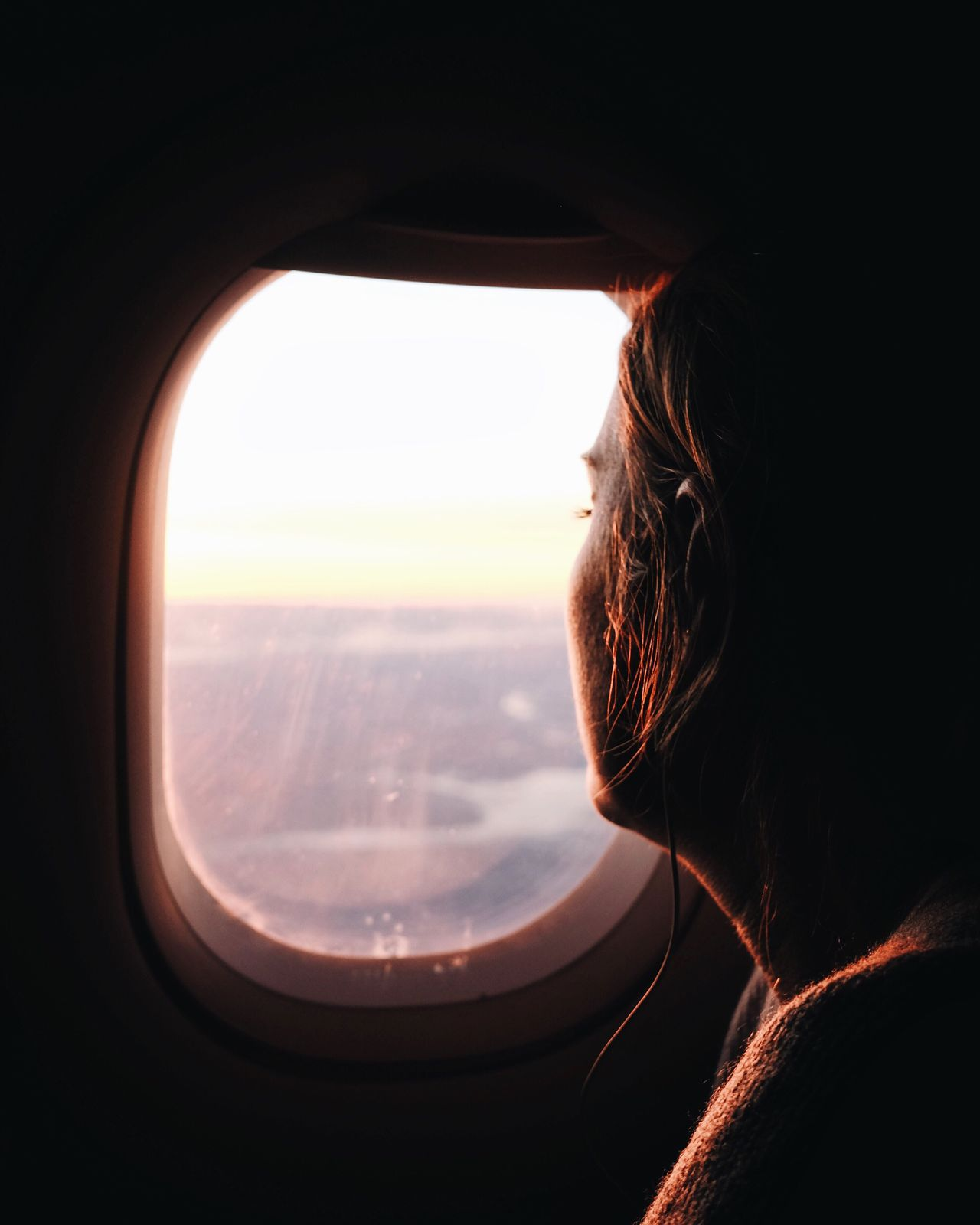 Traveling Home For The Holidays Window Journey Transportation Flying Vehicle Interior Looking Through Window One Person Women Real People Sky Airplane Day Nature Landscape Close-up Adult People Young Adult Outdoors