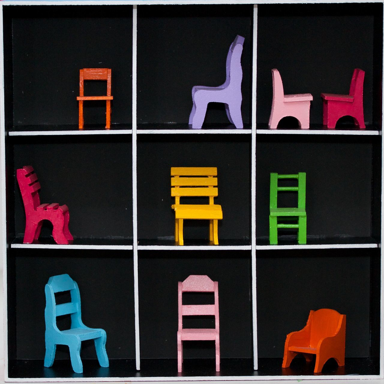 10 miniature chairs in a six square box Black Background Chair Chairs Close-up Day Dollhouse Little Chair Miniature No People