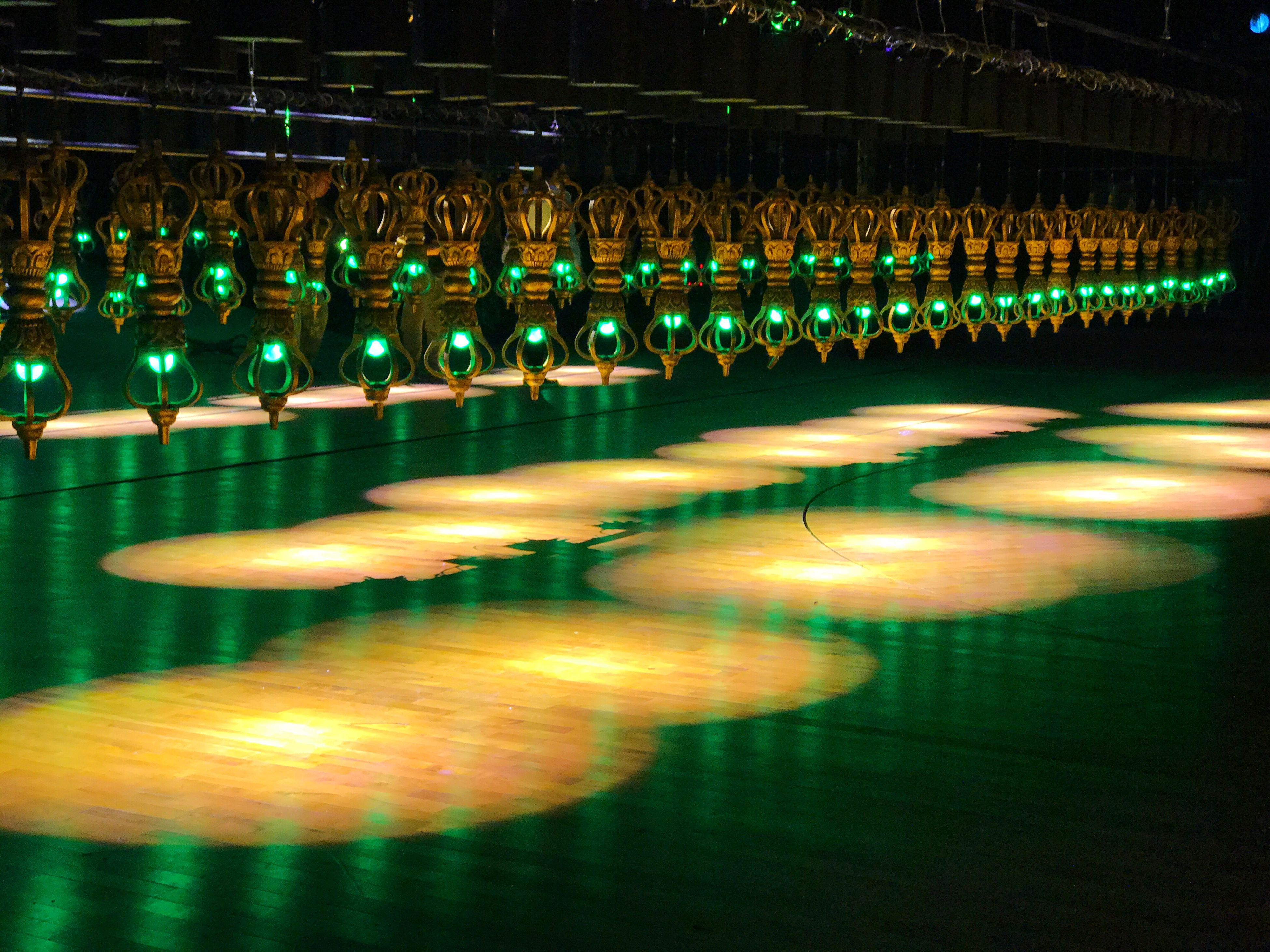 illuminated, reflection, in a row, indoors, no people, large group of objects, night