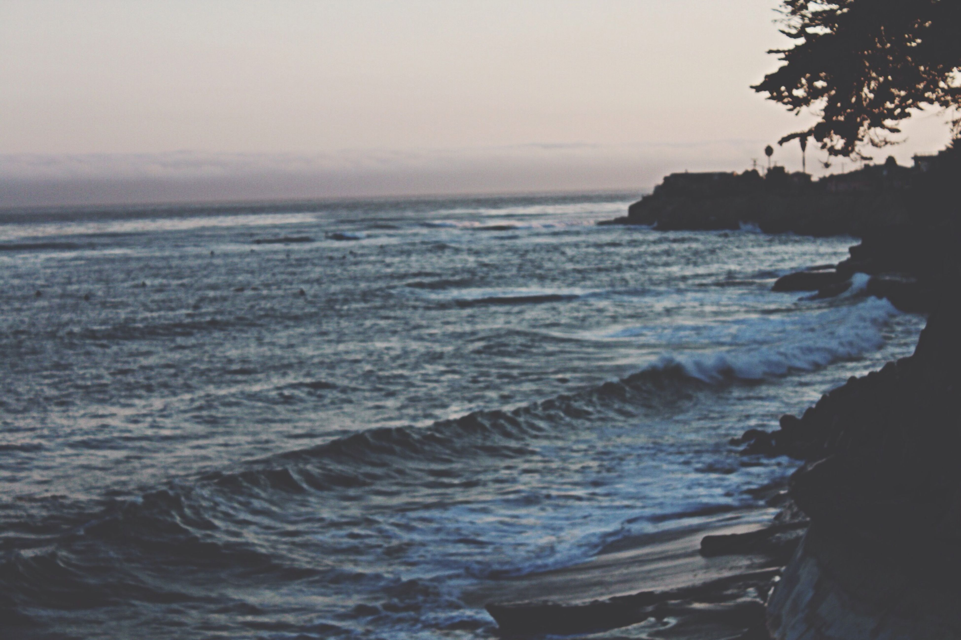sea, water, horizon over water, scenics, beauty in nature, tranquil scene, wave, tranquility, nature, surf, rock - object, clear sky, sky, idyllic, seascape, beach, shore, rock formation, rippled, coastline