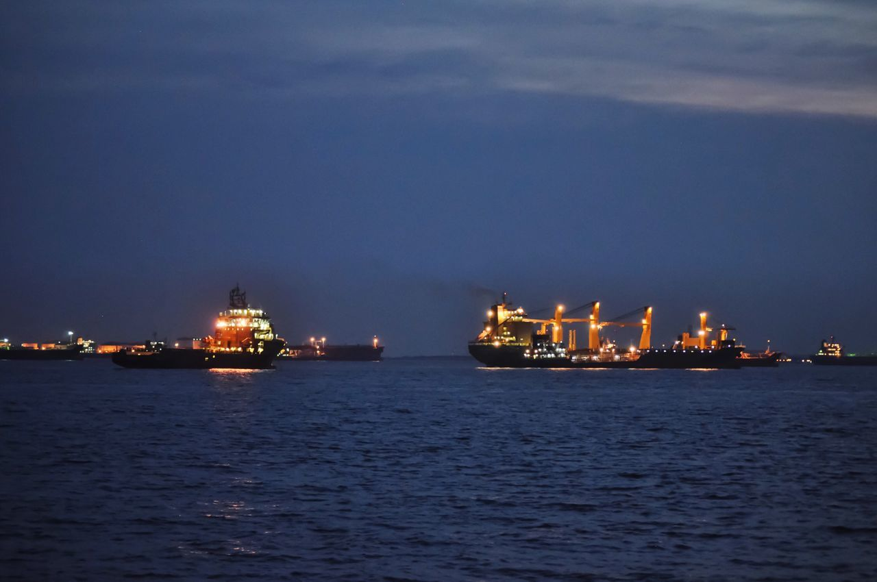 Sea Waterfront Nautical Vessel Water Ship Illuminated Industry Freight Transportation Night No People Shipping  Sky Oil Industry Outdoors Mode Of Transport Transportation Cloud - Sky Built Structure Commercial Dock Offshore Platform Singapore Straits Anchorage Anchoring Anchor Anchored