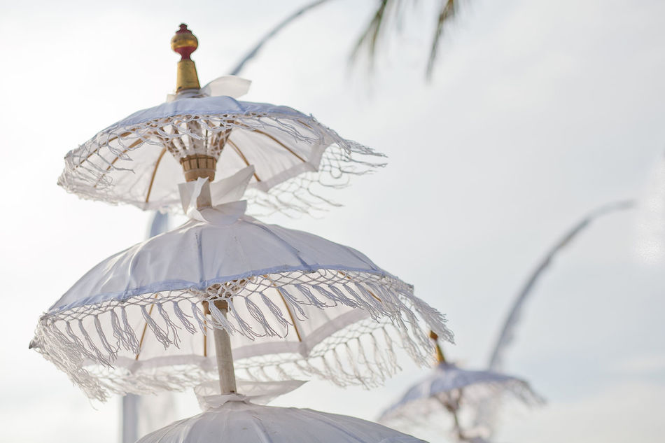 traditions umbrella on the island of Bali Indonesia Bali, Indonesia Beach Celebration Close-up Cultures Day Decor Decorative Low Angle View No People Outdoors Sky Spiritual Traditional Umbrella Water Wedding White