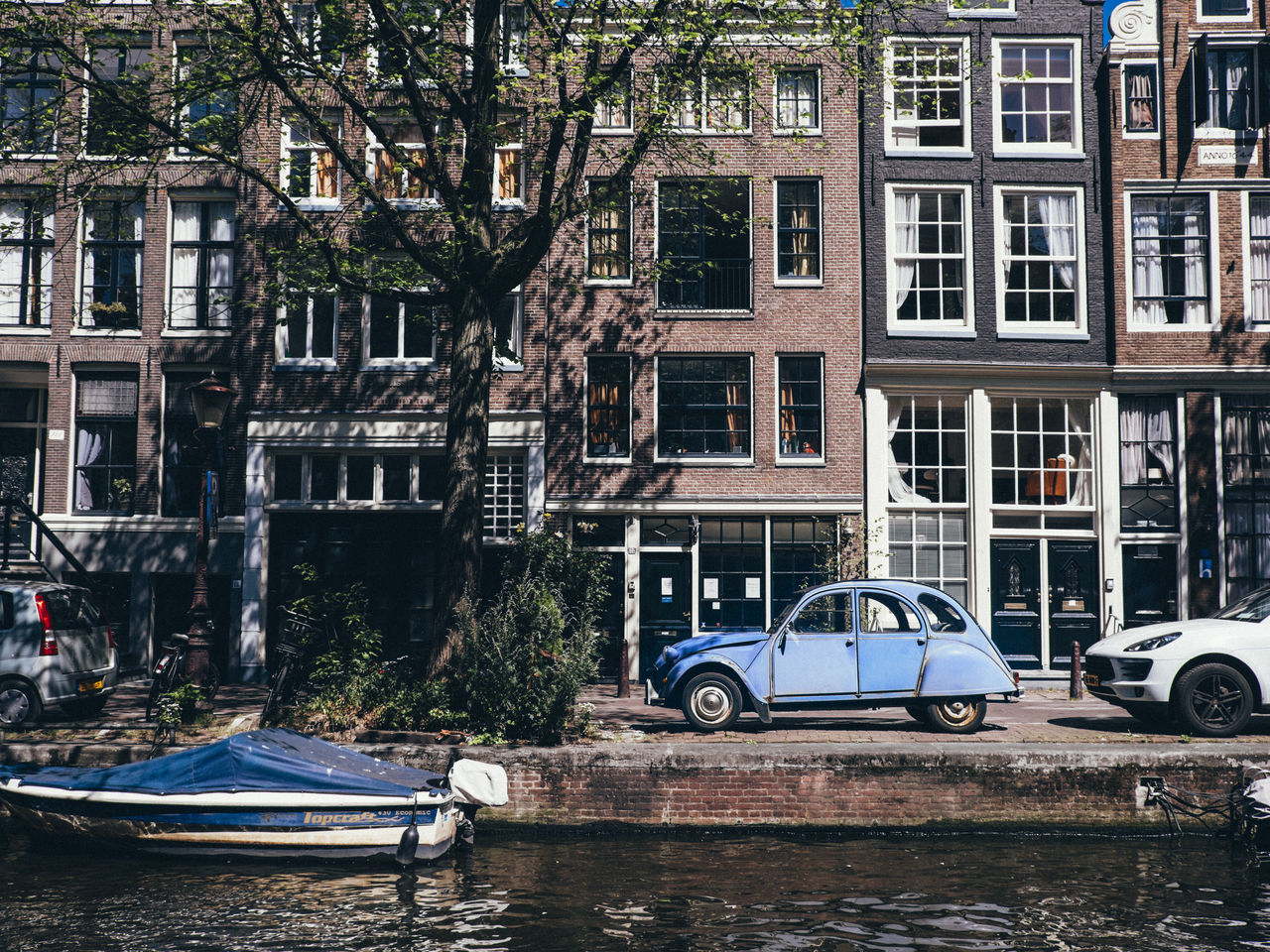 Amsterdam Architecture Building Exterior Built Structure Canal Car City Land Vehicle Mode Of Transport Nautical Vessel Netherlands No People Outdoors Stationary The Architect - 2017 EyeEm Awards Transportation Water