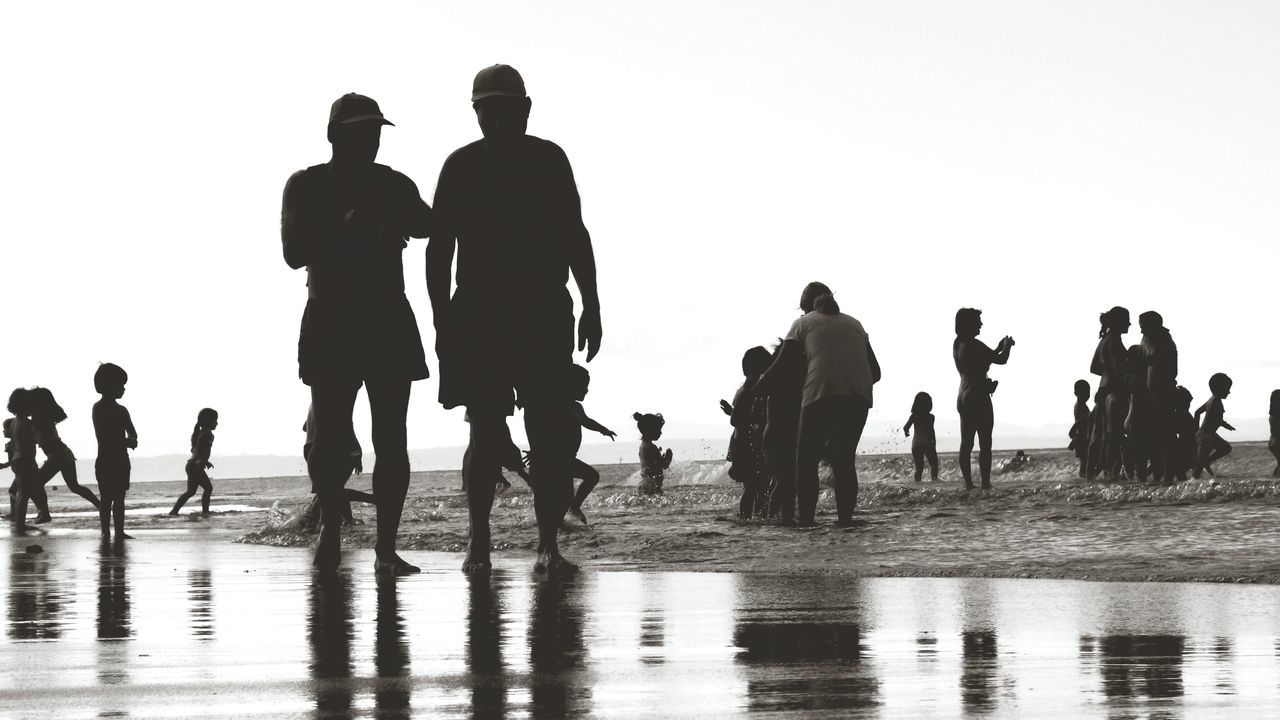 Water Beach Walking People Silhouette Day Sea Outdoors Togetherness Sky Adult Nature Vacation Time Silhouette Large Group Of People Sand Young Adult Children Playing Beach Life Monochrome _ Collection Monochrome Photograhy Black And White Collection