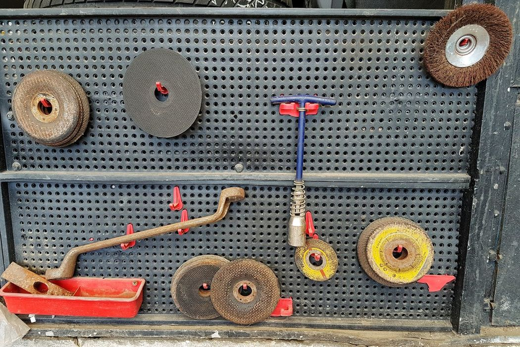 Large Group Of Objects The Week On EyeEm EyeEmNewHere Auto Repair Shop Tools Tools On The Wall Variation Auto Service Jack Crank Small Business Business Finance And Industry Spark Plug Spark Plug Key Grinder Stone Grinder Set