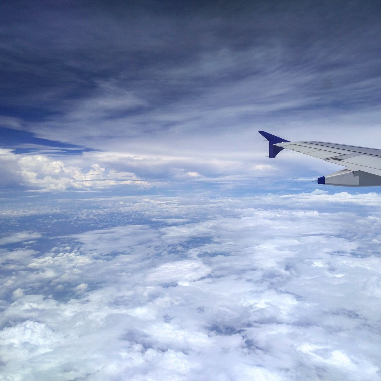 cloud - sky, sky, airplane, transportation, flying, nature, airplane wing, journey, aerial view, no people, beauty in nature, outdoors, day, mid-air, scenics, blue
