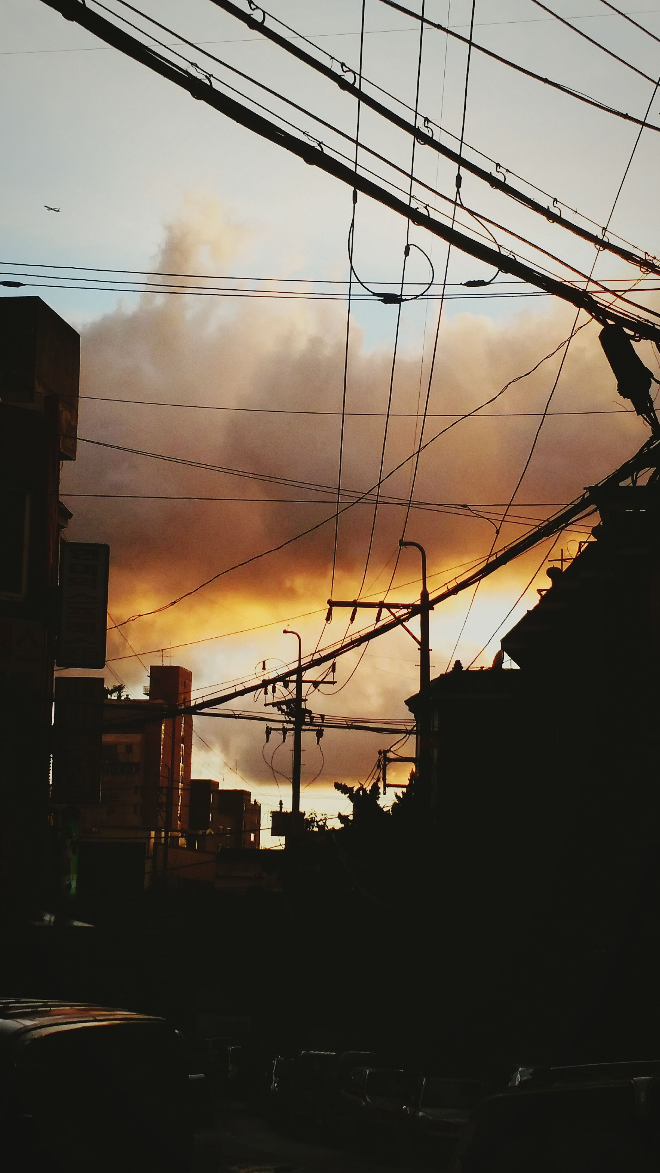 architecture, silhouette, built structure, building exterior, sunset, low angle view, sky, power line, electricity pylon, cable, building, electricity, dusk, connection, city, power supply, cloud - sky, no people, outdoors, residential structure