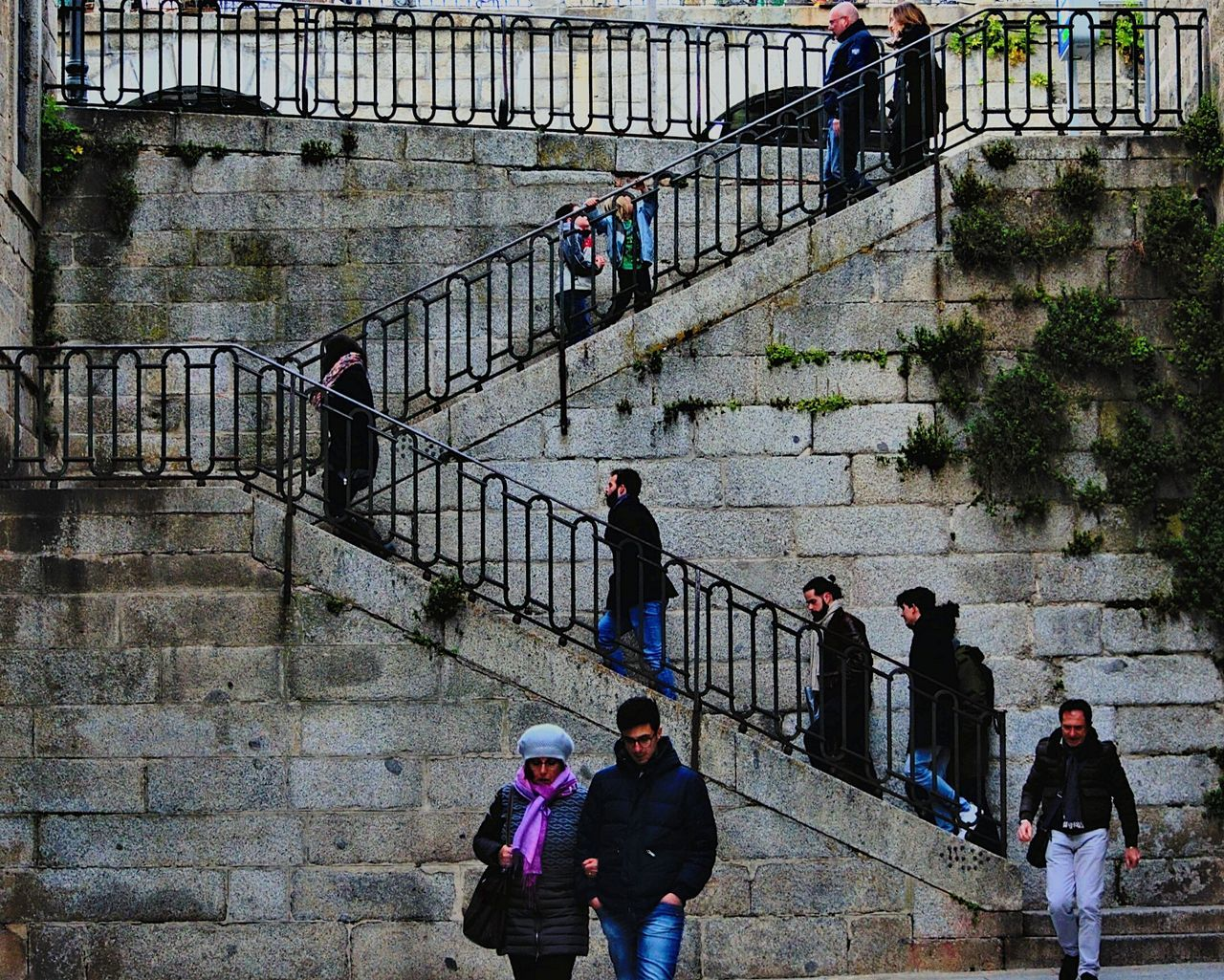 railing, large group of people, steps and staircases, built structure, real people, architecture, lifestyles, steps, men, leisure activity, women, prison, standing, day, outdoors, prisoner, city, people, adult, adults only