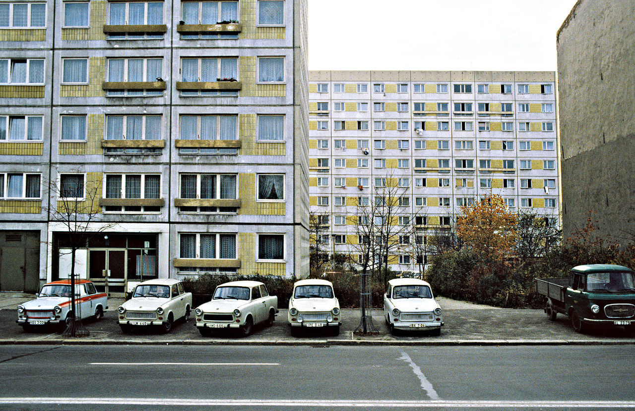 Architecture Building Exterior Built Structure Car City City Street Cityscape Day Houses In East Berlin Mode Of Transport No People Outdoors Socialism Street Trabants In Front Of A Block House Transportation Tristesse Urbaine