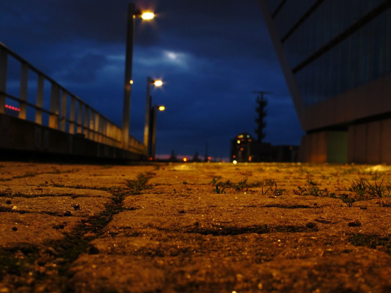 surface level, night, illuminated, transportation, outdoors, sky, no people, built structure, architecture, nature
