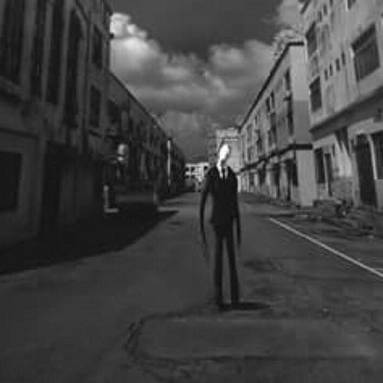 Slenderman is looking at you. Slender SlenderMan Creepy Blackandwhite Bnw Empty Mystery Eerie Dark Mystic Horror Ghost Noface Empty Likeforlikes Building Suit Creepypasta