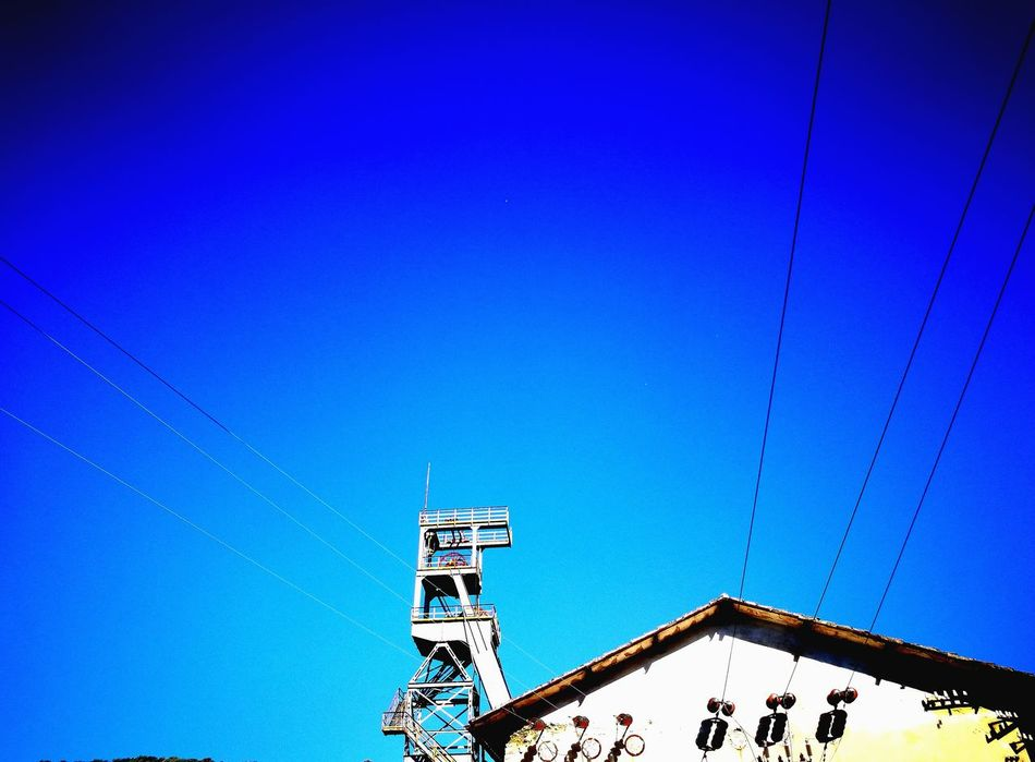 Blue Clear Sky Low Angle View Sky Day Outdoors No People Mining Heritage Mining Industry Abandoned Buildings Derelict Building Ropes Mining Tower
