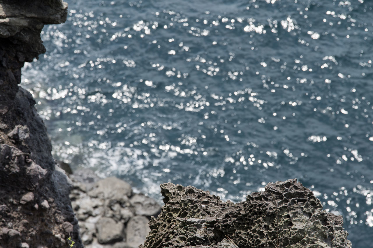 Close-Up Of Rock Formation In Sea