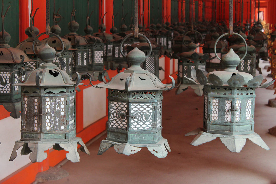 Detail of a row of ornate bronze lanterns as the famous point of shrine in Nara, Japan Ancient Ancient History Bronze Day Hanging Indoors  Japanese Culture Lanterns Nara,Japan No People Ornate Shrine Of Japan Variation