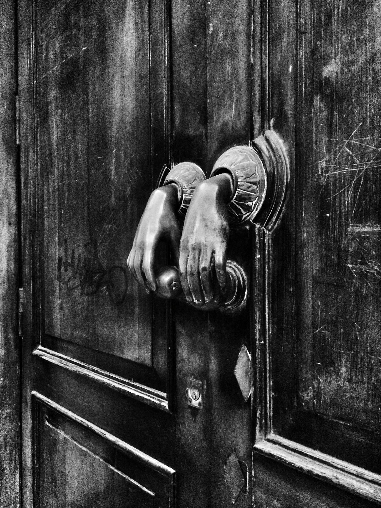 Black&white Creepy Hands Door Knob on an Old Door. Check This Out Scary Stuff