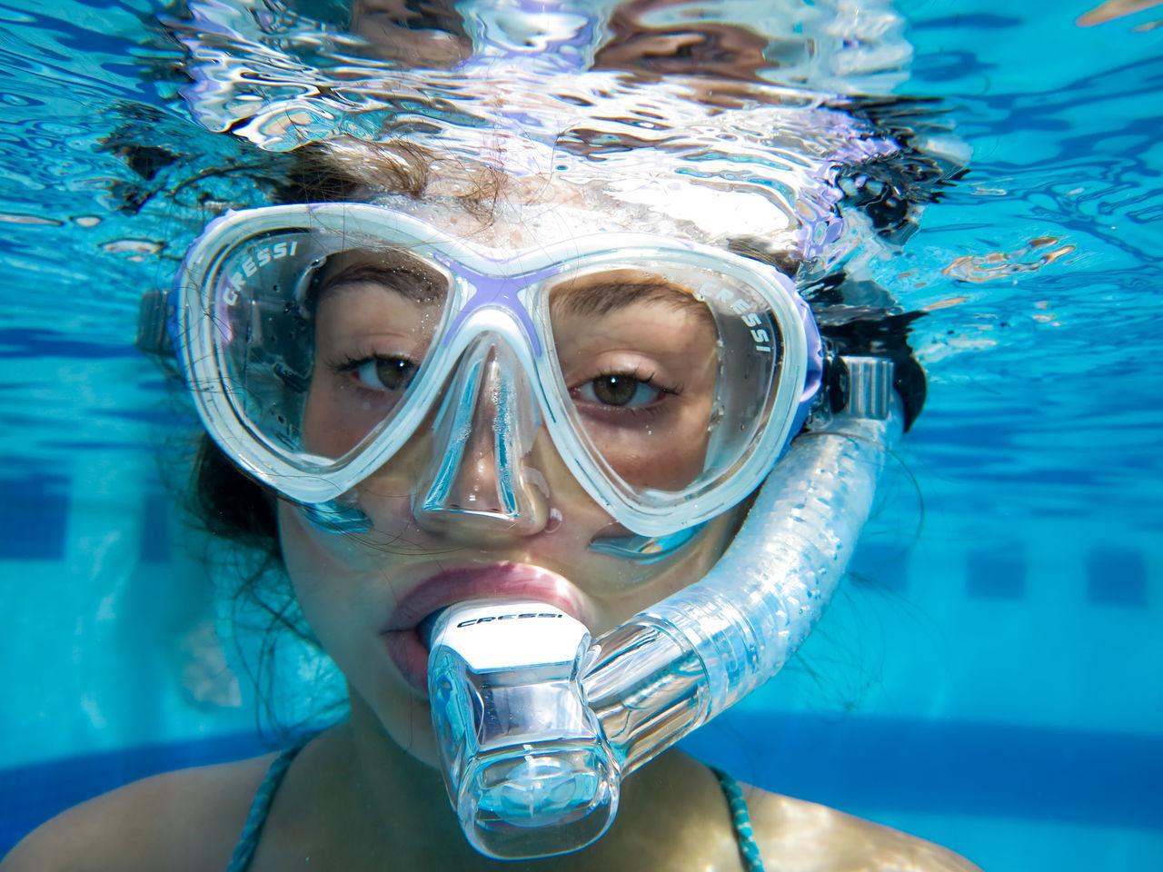 swimming pool, water, swimming goggles, leisure activity, underwater, looking at camera, swimming, front view, real people, one person, portrait, close-up, headshot, outdoors, lifestyles, blue, snorkeling, day, scuba diving, nature, young adult, undersea, people