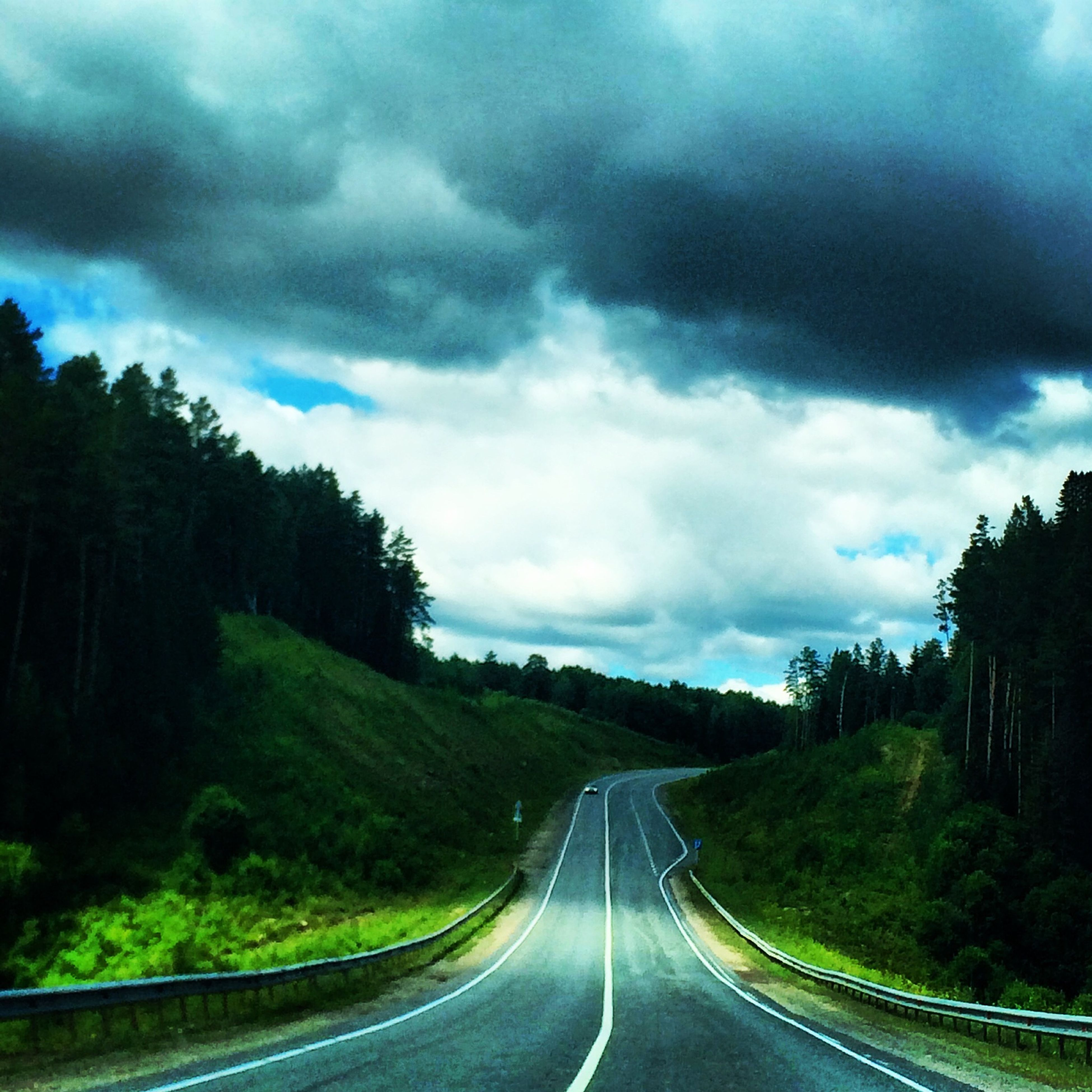 the way forward, transportation, road, diminishing perspective, sky, vanishing point, cloud - sky, tree, cloudy, road marking, country road, cloud, nature, storm cloud, weather, highway, empty road, tranquility, beauty in nature, tranquil scene