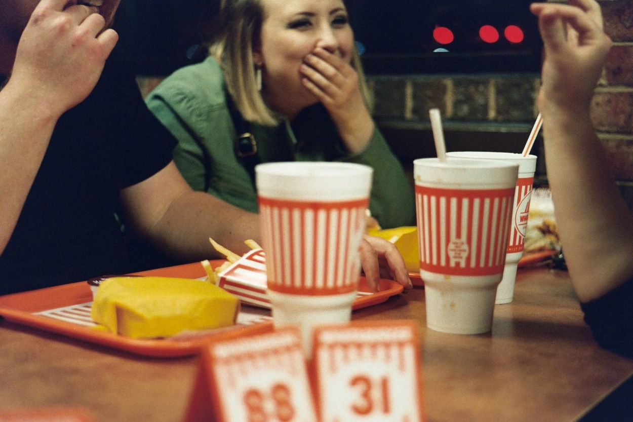 Leisure Activity Film Photography Analogue Photography Unedited Hidden Faces Woman Portrait Storytelling Laughing People Together Fast Food Mealtime Intimate Portraits French Fries Plastic Tray Relaxing Together Friendship Enjoy The New Normal Done That.
