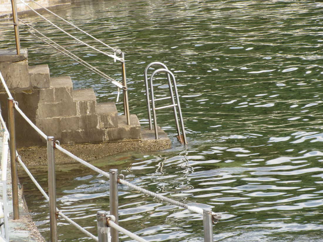 Ladder descending into the sea water . Tuscany, Italy Day Descend Dock Handrail  Holiday Jetty Ladder Mediterranean  Nobody Pier Reflection Relaxing Rise Rope Sea Shore Sinking Stairs Steel Step Stepladder Stile Stone Water Wharf