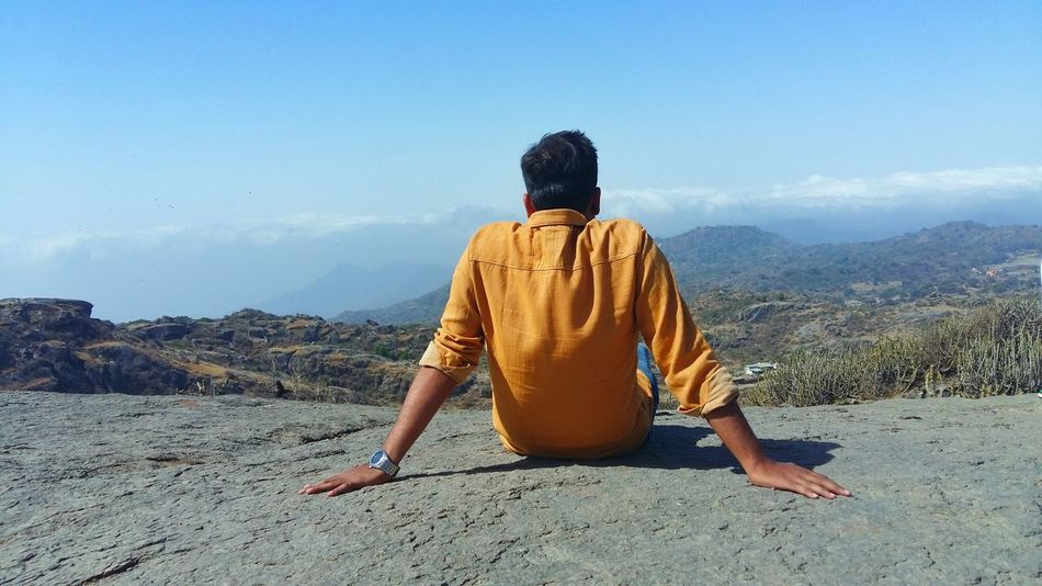 Guru Sikhar at 5650 ft Arbuda Mountains Mountain Mountain Range Aravallis Aravalli Range From Guru Sikhar Mount Abu Rajasthan , India Man Sitting In Rocks Man On Mountain Mountains And Sky Mountain Chilling Adventure Club Chirag Nimavat Landscap Collection