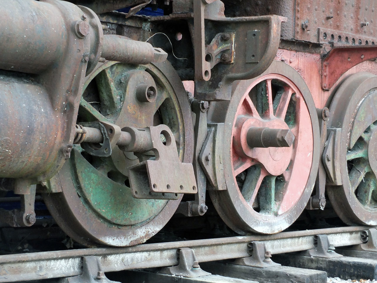 train - vehicle, transportation, mode of transport, metal, rail transportation, wheel, stationary, railroad track, steam train, no people, outdoors, locomotive, day, land vehicle, close-up