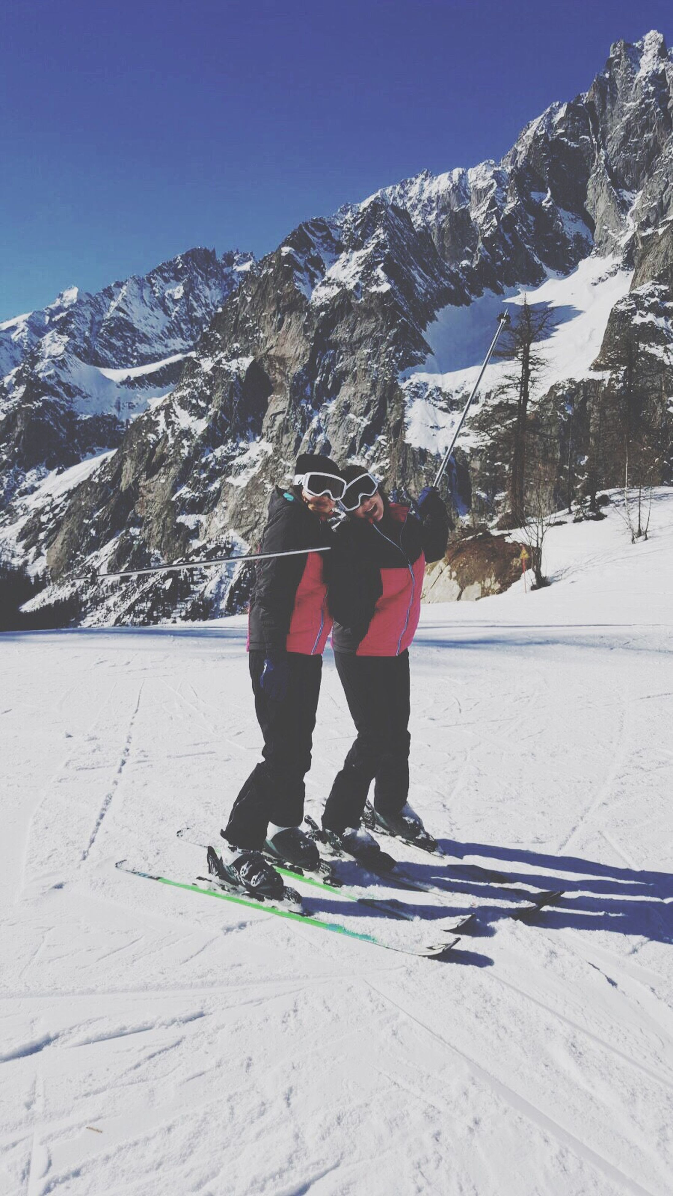 snow, winter, mountain, cold temperature, snowcapped mountain, winter sport, full length, two people, ski holiday, ski-wear, snowboarding, rear view, mountain range, outdoors, adventure, sport, skiing, people, happiness, adults only, day, adult, warm clothing, nature, only women, young adult, human body part, sky