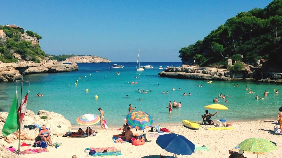 Beach Sea Water Large Group Of People Vacations Leisure Activity Shore Horizon Over Water Tourist Blue Lifestyles Clear Sky Enjoyment Tourism Relaxation Sand Person Weekend Activities Summer Fun Mallorca