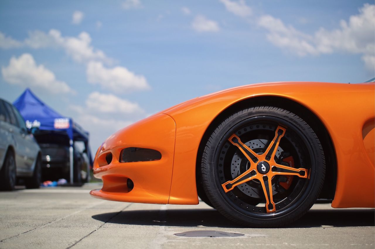 The Beast... Tire Cloud - Sky Car Wheel Land Vehicle Transportation Yellow Close-up Details Of My Life Made In Romania My Favorite Photo VSCO Ride Speed Luxury Summer Sportscar Sports Car The Great Outdoors - 2017 EyeEm Awards Outdoors Lines Orange Freshness Rich Car Show