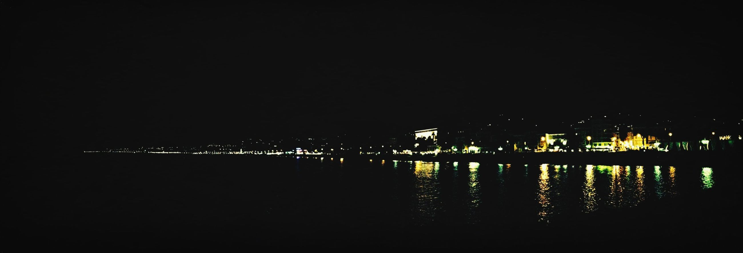 water, night, illuminated, reflection, waterfront, lake, copy space, river, tranquility, tranquil scene, clear sky, sea, pier, silhouette, nature, scenics, dark, outdoors, sky, built structure