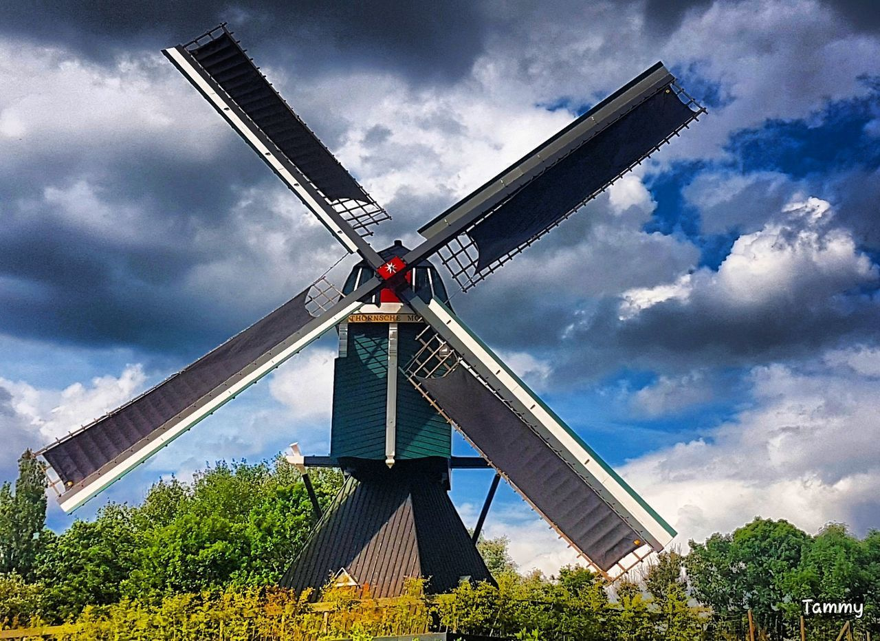 cloud - sky, sky, renewable energy, alternative energy, wind power, windmill, day, architecture, wind turbine, built structure, outdoors, field, low angle view, fuel and power generation, traditional windmill, no people, building exterior, tree, nature, industrial windmill, technology
