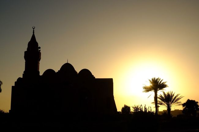 When the sunset kisses the mosque Check This Out Illuminated Mosque Sunset Tranquility Silhouette Beauty In Nature Sky Orange Tranquil Scene Outdoors Travel Destinations Jeddah Saudi Arabia