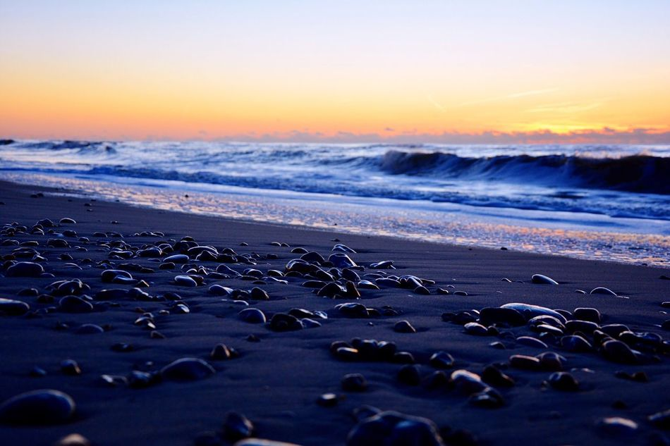 Traveling Home For The Holidays Sea Beach Nature Sunset Beauty In Nature Water Horizon Over Water No People Tranquil Scene Wave Sand Outdoors Stones