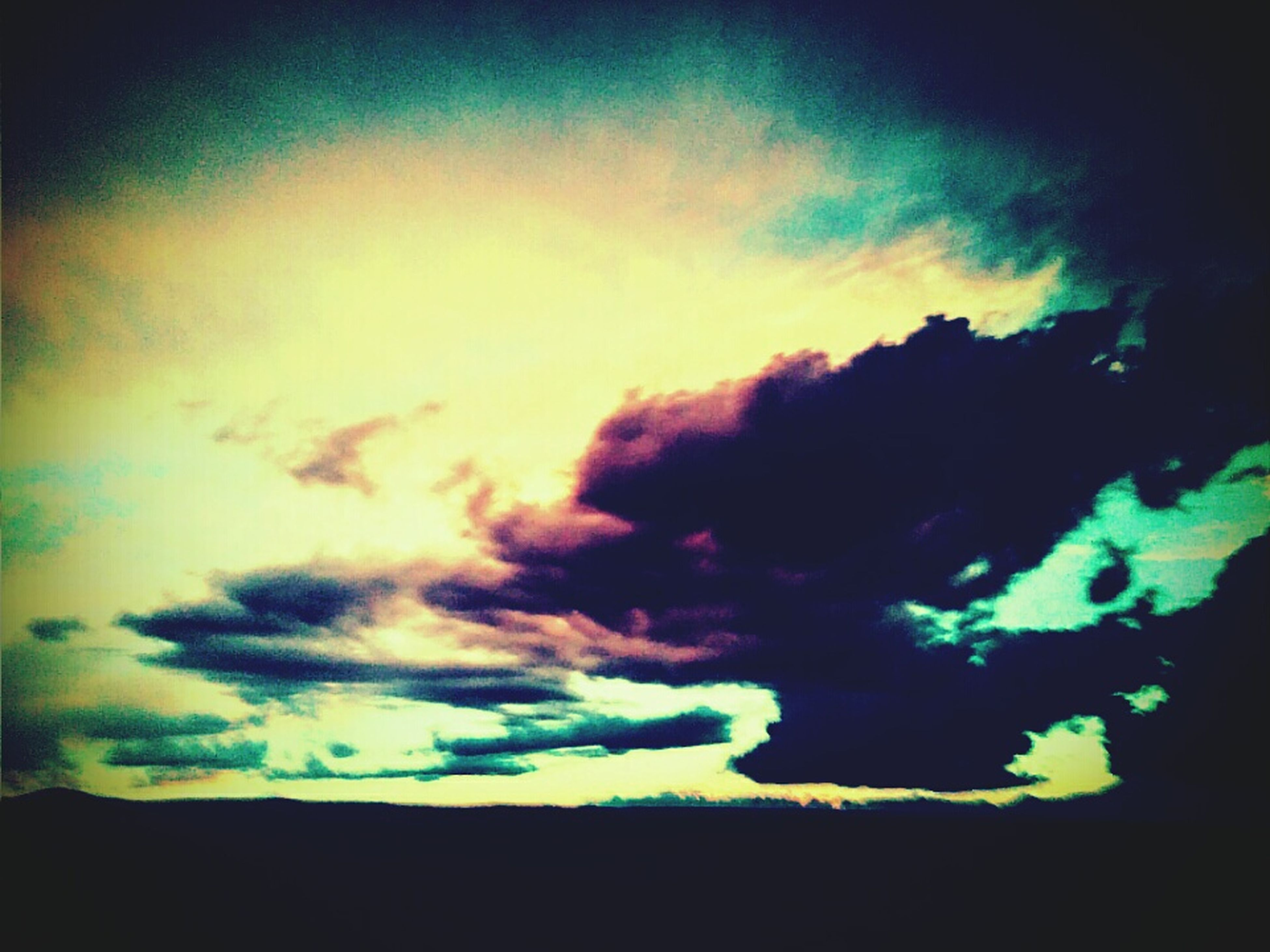 sky, cloud - sky, sunset, silhouette, beauty in nature, scenics, cloudy, low angle view, tranquility, tranquil scene, cloud, nature, dramatic sky, auto post production filter, dusk, idyllic, transfer print, weather, outdoors, dark