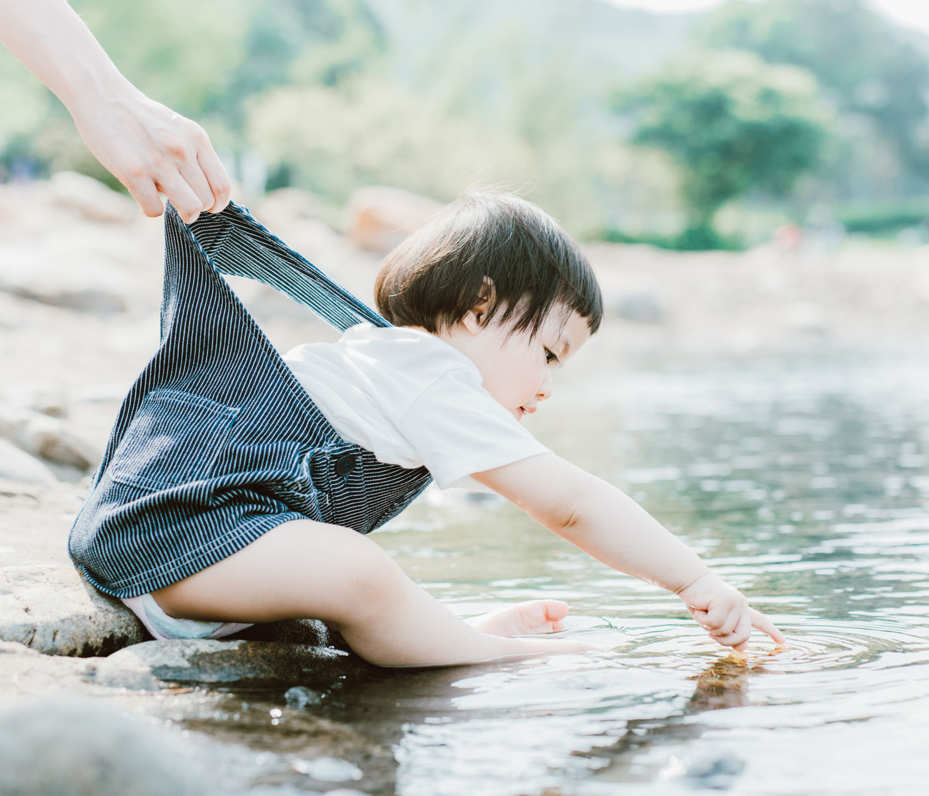 Boys Childhood Day Holding Human Hand Leisure Activity Lifestyles One Person Outdoors Playing Real People Water