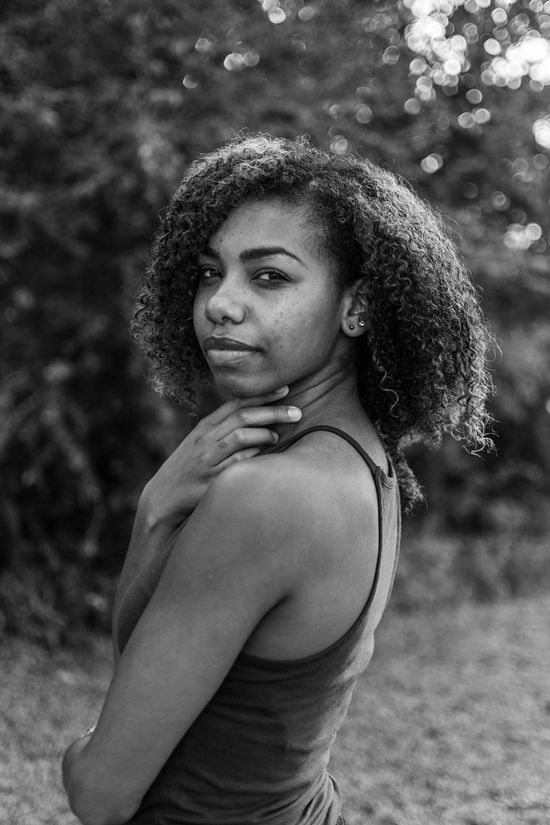 """""""thinking of you."""" Beautiful Woman Beauty Black And White Check This Out Creole Curly Hair Day Focus On Foreground Lifestyles Looking At Camera Nature One Person Outdoors People Portrait Real People Taking Photos The Portraitist - 2017 EyeEm Awards Tree Young Adult Young Women EyeEm Selects"""