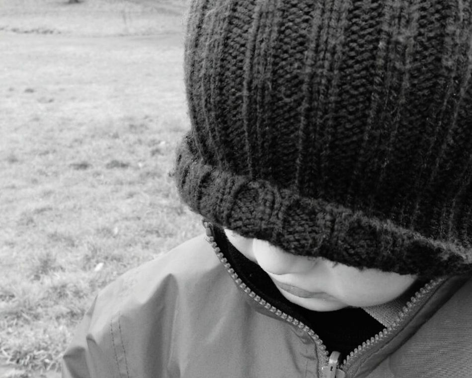 Real People One Person Knit Hat Headshot Outdoors Grass Warm Clothing Close-up People Boy Kid Child Hat HEAD Jacket Face Cheeks Lips Mouth Toddler  Day Black And White Park Childhood
