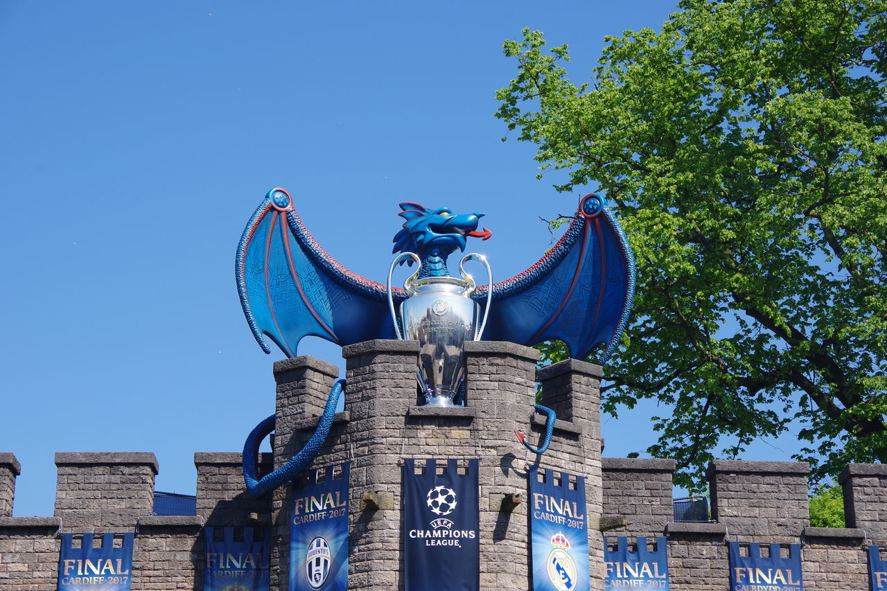 Cardiff Cardiff Castle Wales Champions League Craft Blue Sculpture Statue Clear Sky No People Business Finance And Industry Sky Architecture Arts Culture And Entertainment Day Tree Outdoors City Juventus Real Madrid Real Madrid C.F.
