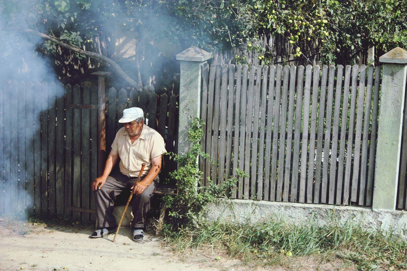 Old man relaxing. Romania Old Man Fence Smoke EyeEm Best Shots EyeEm Best Shots - People + Portrait