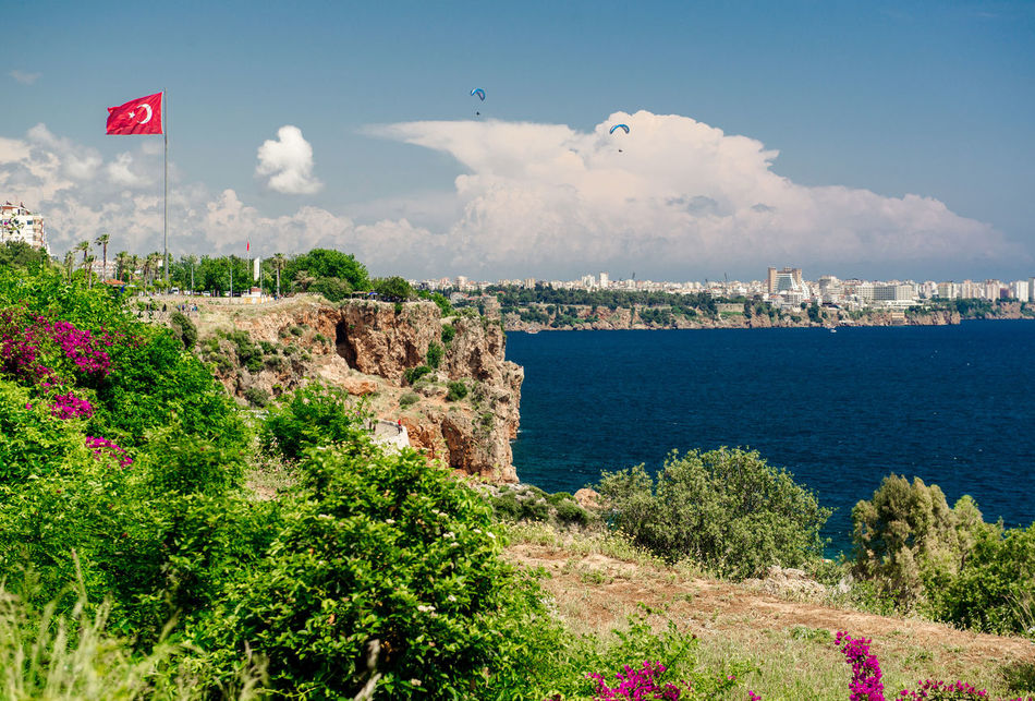 Antalya city. It is biggest international sea resort in Turkey Antalya Turkey Bush City Clouds And Sky Coast Day Flag Flag Of Turkey Flower Landscape Mediterranean  Middle East Nature Outdoors Sea Summer Sunny Day Tourism Travel Destinations Tropical Climate Turkey Turkish Riviera Water Waterfront Waving Flag