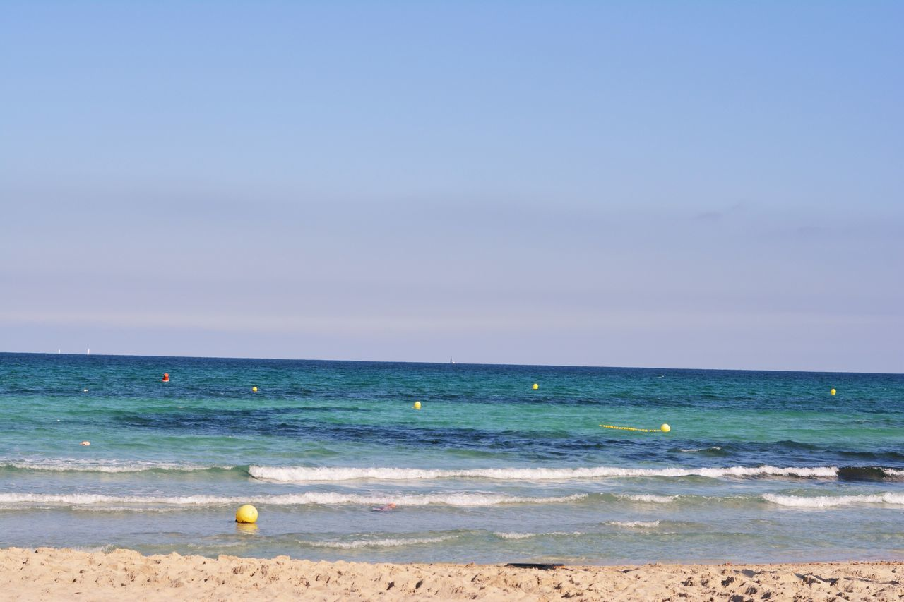 sea, horizon over water, beach, water, nature, beauty in nature, scenics, tranquility, tranquil scene, sky, blue, outdoors, wave, no people, sand, day
