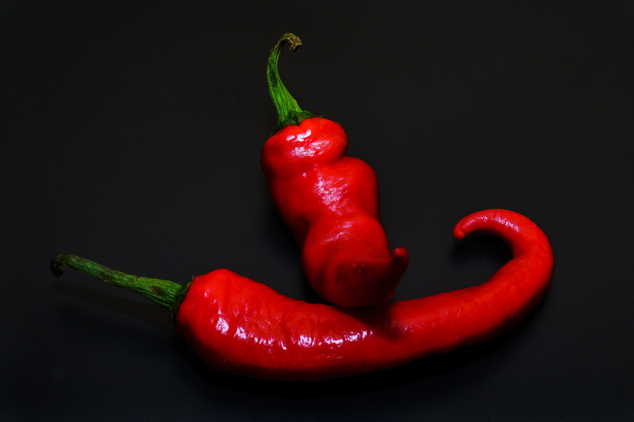 Chili Pepers with black back ground Black Background Blackandwhite Chili Pepper Close-up Food Freshness Healthy Eating No People Red Red Bell Pepper Red Chili Pepper Spice Studio Shot Vegetable
