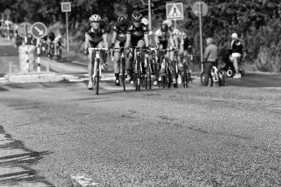 UCI Women´s WorldTour in the background (2013) - Asphalt Adults Only Athlete Black And White Competition Competitive Sport Crowd Cycling Helmet Day Defocused Exceptional Photographs Focus On Foreground Group Of People Hello World Human Muscle Outdoors People Professional Sport Racing Bicycle Road Showing Imperfection Speed Sport Sports Race Track And Field Athlete
