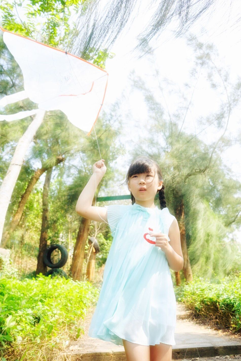 My little fairies❤️ Sunlight Child Standing Waist Up One Person Outdoors Children Only Portrait Looking At Camera Sunbeam Childhood One Girl Only Nature Front View Day People Smiling Grass Beauty Tree Flying A Kite