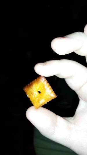 Human Hand Human Body Part One Person Human Finger Close-up People Holding Night Black Background Indoors  Cheez-it Toasted Snacks!