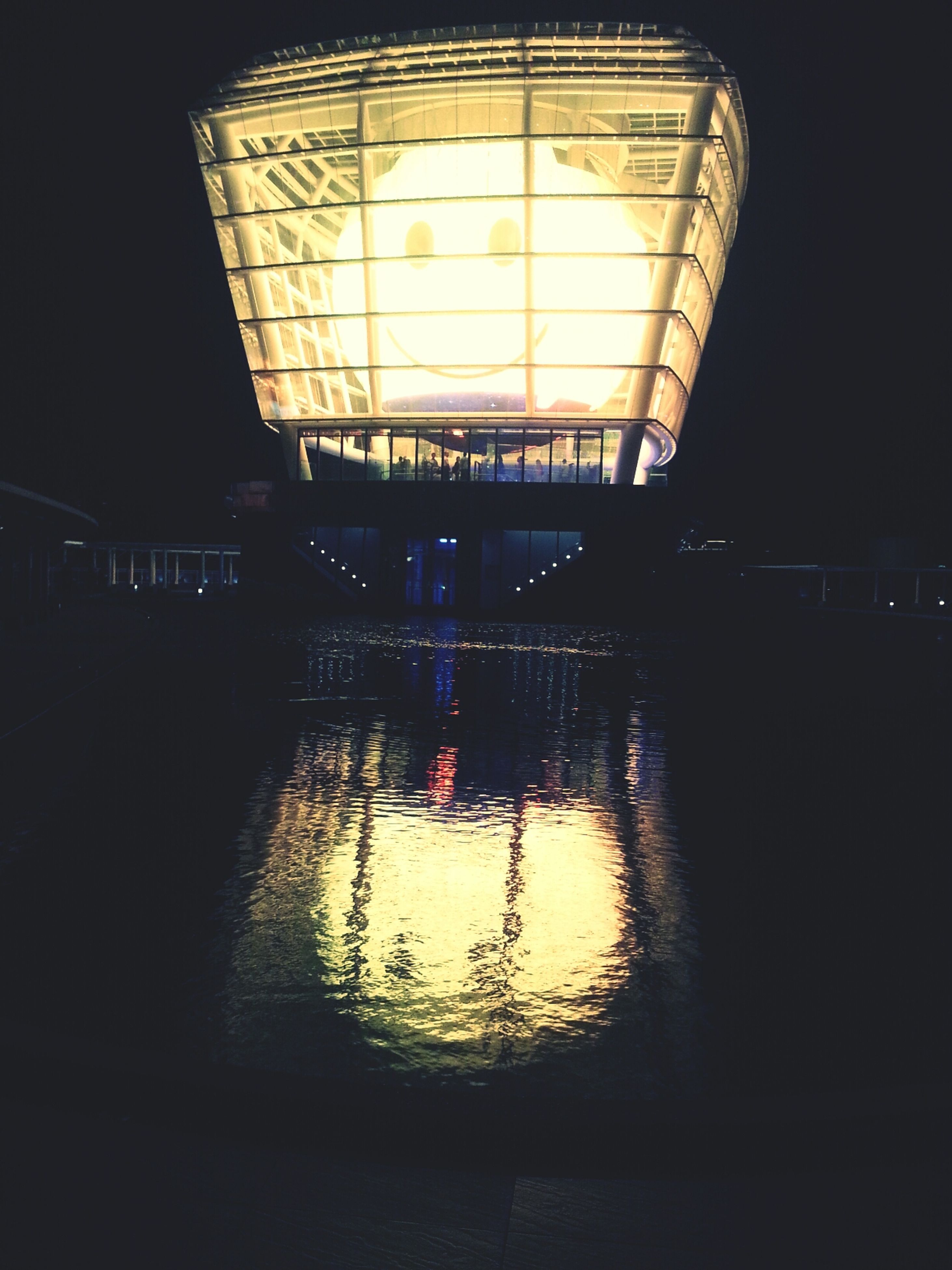 architecture, built structure, reflection, water, indoors, illuminated, night, transportation, building exterior, waterfront, window, silhouette, building, sunset, river, no people, dark, connection, bridge - man made structure, mode of transport