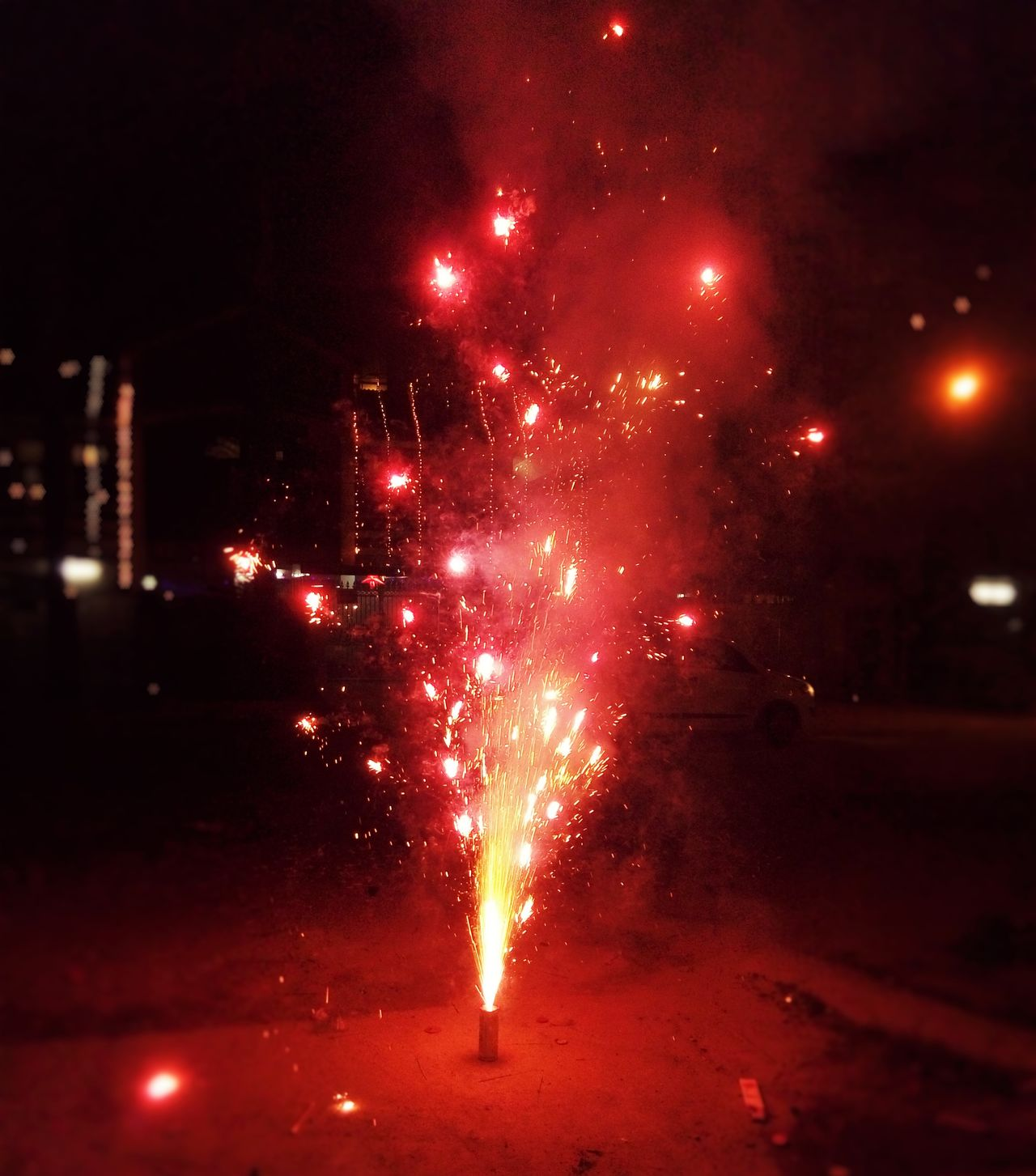 Celebration Exploding Firework - Man Made Object Firework Display Glowing Illuminated Motion Night No People Outdoors Red Sky Smoke - Physical Structure Sparks